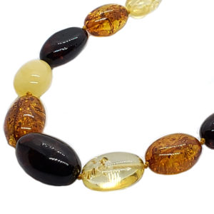 Multicolor Amber Olive Shaped 20 inches long beads.