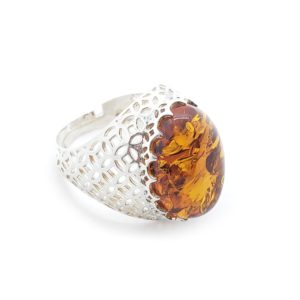 Oval Cognac Amber Filigree Silver Adjustable Ring. Oval shaped amber stone set in filigree design 925 sterling silver. Adjustable amber ring.