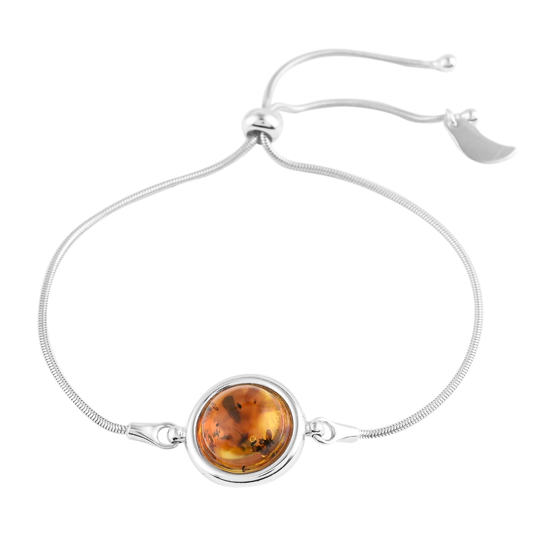 Cognac Amber Oval-Shape Stones Adjustable Bracelet. Polished cognac color amber stones set in .925 sterling silver. Genuine Baltic amber.