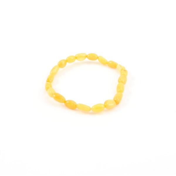 Antique Color Amber Stretch Bracelet. Irregular- shape amber beads set on elastic cord. Genuine Baltic amber bracelet.